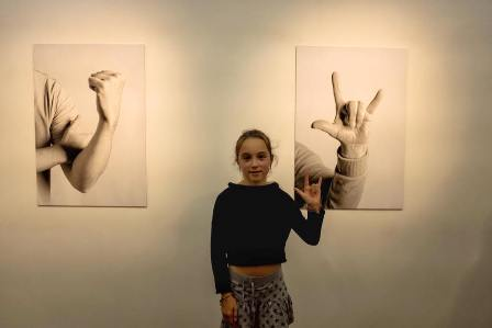 Girl posing in front of Art