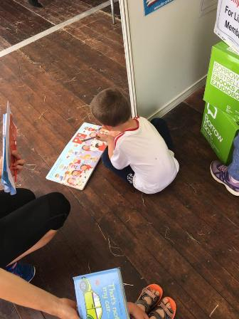 Young boy reading on the floor
